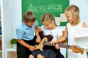 Three children with guitar