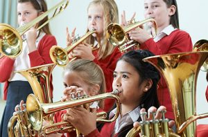 Girls playing brass instruments